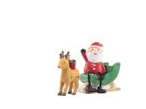 Reniferowy lug zieleni sanie Santa Claus siedzi dalej gestykuluje twój ręka Zdjęcia Stock