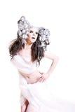 Renivellement créateur et cheveu sur une fille de mode photo libre de droits