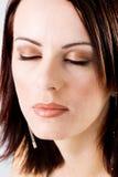 Renivellement de Glamor sur le visage d'une femme Photo stock