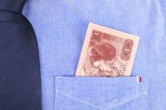 Renminbi в карманн Стоковая Фотография RF