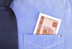 Renminbi в карманн Стоковая Фотография