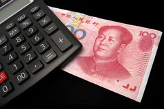 Renminbi and calculator Royalty Free Stock Images