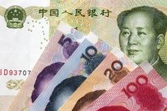 Renminbi de yuans, devise de porcelaine, pièce de monnaie et billet de banque Photographie stock