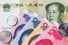 Renminbi de yuans, devise de porcelaine, pièce de monnaie et billet de banque Images stock