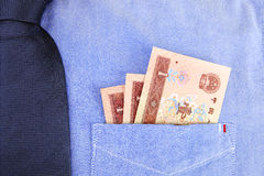 Renminbi in pocket. RMB in pocket of shirt Royalty Free Stock Images