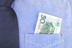 Renminbi in pocket Stock Photos