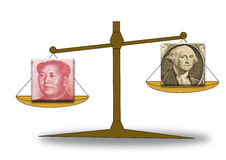 Renminbi and US dollar on a scale Royalty Free Stock Photography