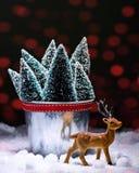 Renna con gli alberi di Natale Fotografia Stock Libera da Diritti