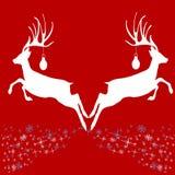 Renna due con le stelle su fondo rosso Immagini Stock
