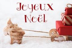 Renne avec le traîneau sur la neige, Joyeux Noel Means Merry Christmas Photo stock