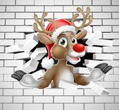 Renne dans le mur de Santa Hat Cartoon Breaking Brick Images stock