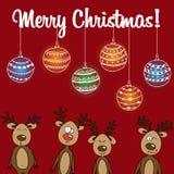 Renne de carte et boules uniques de Noël Photographie stock libre de droits