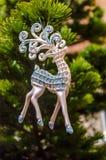 Renne de jouet d'arbre de Noël Photographie stock