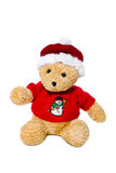Renne de peluche avec le chapeau de Santa d'isolement avec un chapeau rouge de Noël Image libre de droits