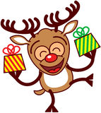 Renne heureux de Noël apportant des cadeaux Images libres de droits