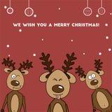 Renne très coloré de la carte de Noël trois Photo libre de droits