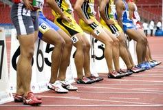 Rennen 100 Meters van mensen Begin Stock Foto