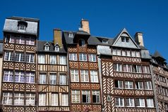 Rennes. The half-timbered buildings of historic Rennes, Brittany, Northern France, against clear blue sky Stock Photography