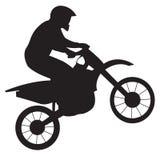 Rennläufer auf Motorrad Stockfotos