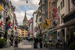 Rennweg Street with St.Peter Church on the background. Switzerland Royalty Free Stock Photo
