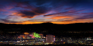 Reno city in Nevada at night. With a dramatic sunset in the background, USA Stock Image