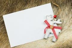 Reno con la letra blanca para la Navidad Foto de archivo