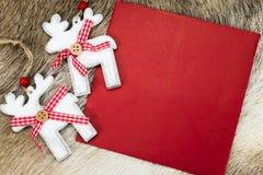 Reno con la letra roja para la Navidad Imagen de archivo libre de regalías