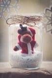 Reno de la Navidad en la decoración de cristal del tarro Foto de archivo libre de regalías