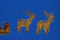 Reno de las iluminaciones con el trineo para Papá Noel Fotos de archivo libres de regalías