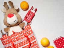 Reno del juguete de la Navidad como regalo Imágenes de archivo libres de regalías