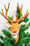 Reno en el árbol de navidad Imagen de archivo