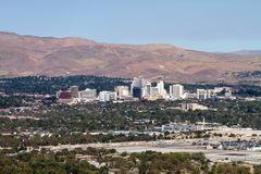 Reno Nevada Skyline. The city skyline of Reno, Nevada with the surrounding urban area and foothills in the distance Royalty Free Stock Image