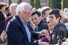 RENO, NV - October 25, 2018 - Bernie Sanders smiling while meeting with attendees in crowd at a political rally on the UNR campus. Bernie Sanders smiling while royalty free stock photography
