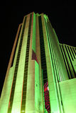 Reno Tall Building. Tall Building in Reno lit up green at night stock photography