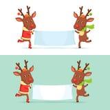 Renos de la Navidad con los carteles Imágenes de archivo libres de regalías