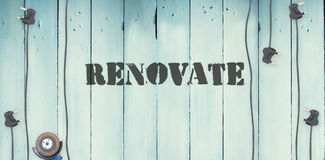Renovate  against plugs on wooden background. The word renovate  against plugs on wooden background Stock Image