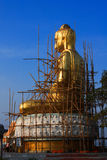 Renovate golden buddha statue. Stock Photos