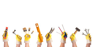 Renovate. Hands with working gloves and tools before white background Stock Photography