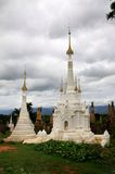 Renovated ancient temple ruins in Inthein, Myanmar. Renovated with white paint ancient temple ruins in Inthein, Inle lake, Myanmar Royalty Free Stock Image