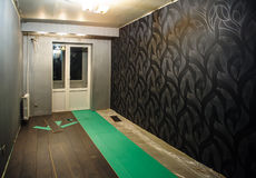 Renovated apartment. The process of laying laminate Stock Image