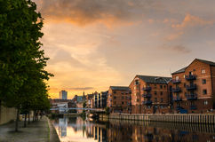 Renovated Building along a River at Sunset stock photo