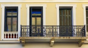 The Renovated Facade of the Old Italian House with Balcony, Crete, Greece Royalty Free Stock Images