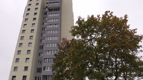 Renovated high flat apartment house and autumn tree stock footage