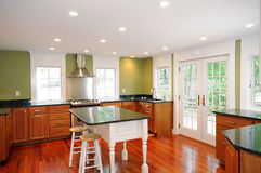 Renovated  Kitchen. Renovated home interior with granite kitchen island and counter-top Royalty Free Stock Photos