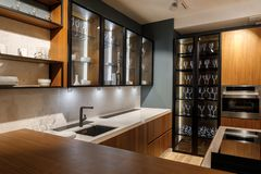 Renovated kitchen interior with glass cabinets stock photography