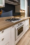 Renovated kitchen interior with white cabinets royalty free stock photos