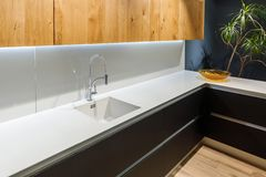 Renovated kitchen interior with white sink royalty free stock images