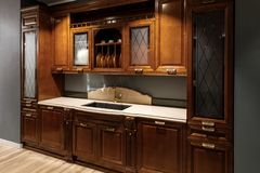 Renovated kitchen interior with wooden cabinets and sink royalty free stock image
