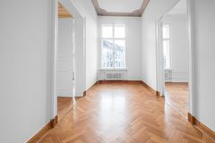 Renovated old building room, flat with stucco ceiling and parquet floor.  royalty free stock photography