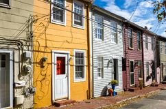 Old Colourful Wooden Houses under Blue Sky. Renovated Old Colourful Wooden Row Houses on a Sunny Autumn Day. Annapolis, MD royalty free stock photography